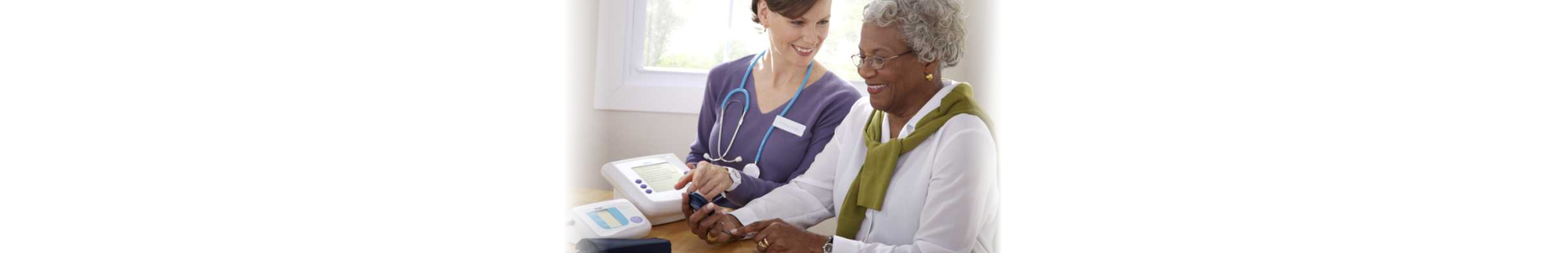 nurse wearing stethoscope talking to an old woman